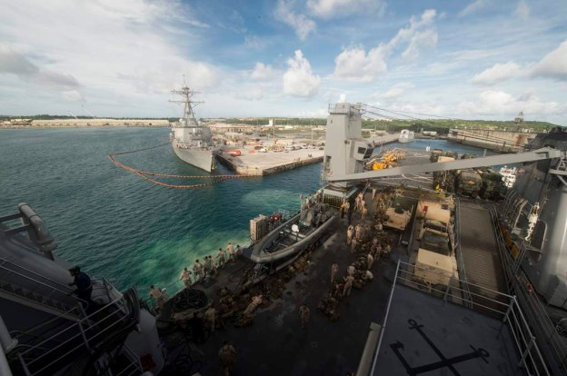 Marines prepare to disembark amphibious dock landing ship USS Harpers Ferry (LSD-49) in Guam on Sept. 12, 2013. US Navy Photo
