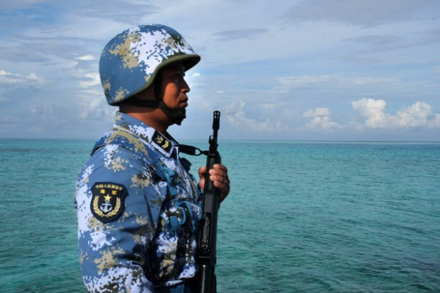 Chinese soldier near the Johnson South Reef. Xinhua Photo