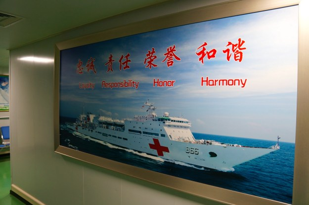 A sign onboard Peace Ark in Chinese and English. Kyle Mizokami Photo