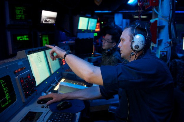 Lt. Richard Ray discusses the bi-lateral U.S. and Republic of Korea Navy's Surface Ship Anti-Submarine Warfare Readiness and Effectiveness Measure (SHAREM) exercise with Lt. Hyeoung Seok Noh, Republic of Korea Navy, in the combat information center aboard USS John S. McCain (DDG-56) on June 3, 2014. US Navy Photo