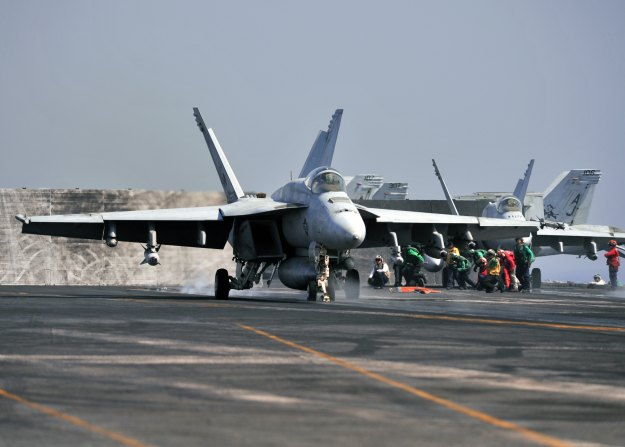 F/A-18E Super Hornet, attached to the Tomcatters of Strike Fighter Squadron (VFA) 31, launches from the flight deck of the aircraft carrier USS George H.W. Bush (CVN-77) on July 31, 2014. US Navy Photo