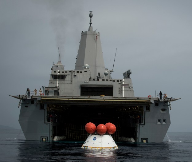 The Orion test capsule enters the welldeck of USS Anchorage (LPD-23) as part of ongoing testing. US Navy Photo