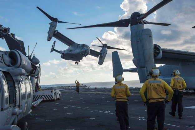 MV-22 Osprey assigned to Marine Medium Tiltrotor Squadron (VMM) 163 launches from USS Makin Island (LHD-8) on Aug. 24, 2014. US Navy Photo