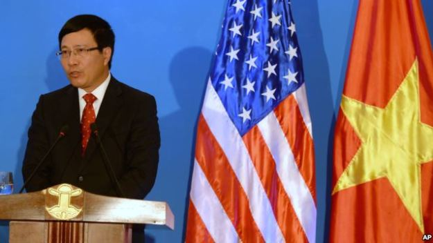 Vietnamese Foreign Minister Pham Binh Minh speaks during a joint press conference with U.S. Secretary of State John Kerry in Hanoi, Dec. 16, 2013. Voice of America Photo