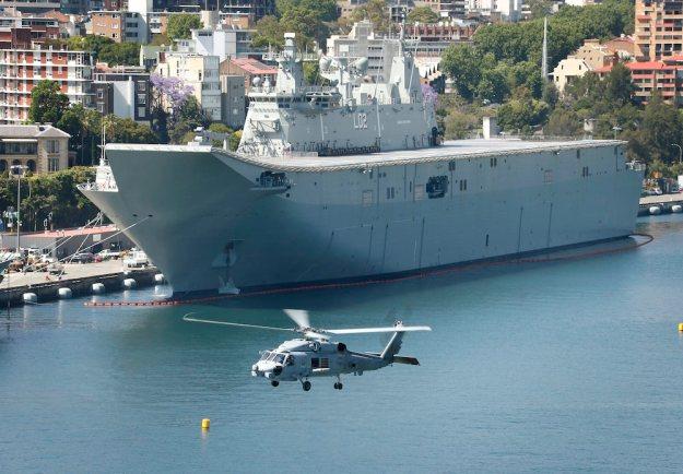 Royal Australian Navy MH60R 'Romeo' Seahawk, flies past HMAS Canberra. RAN Photo