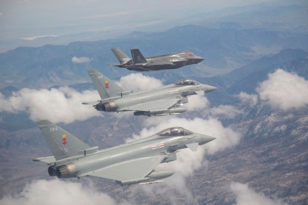 F-35 BF-17 from the F-35 Integrated Test Force in Formation with RAF Typhoons, Edwards AFB, Calif. April 4, 2014. DoD Photo