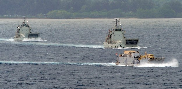 HMAS Balikpapan, Landing Craft Heavy (LCH) L133 HMAS Betano, and Landing Craft Utility (LCU) 1665 transit out of the Segond Channel during Pacific Partnership 2011. US Navy Photo