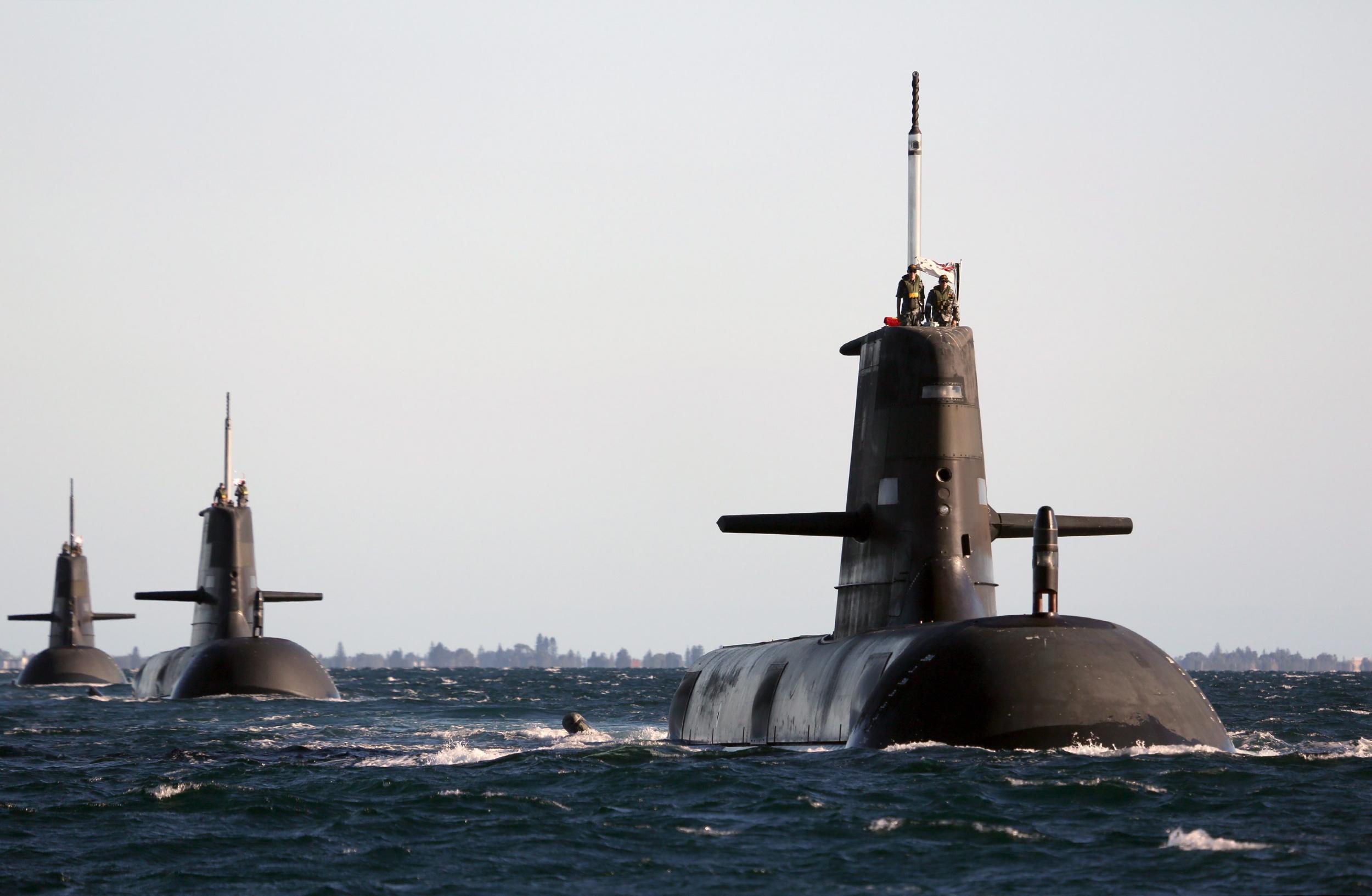 Collins-class attack boats HMAS Dechaineux leads HMAS Waller and HMAS Sheean in formation in Cockburn Sound, near Rockingham Western Australia in 2013. RAN Photo