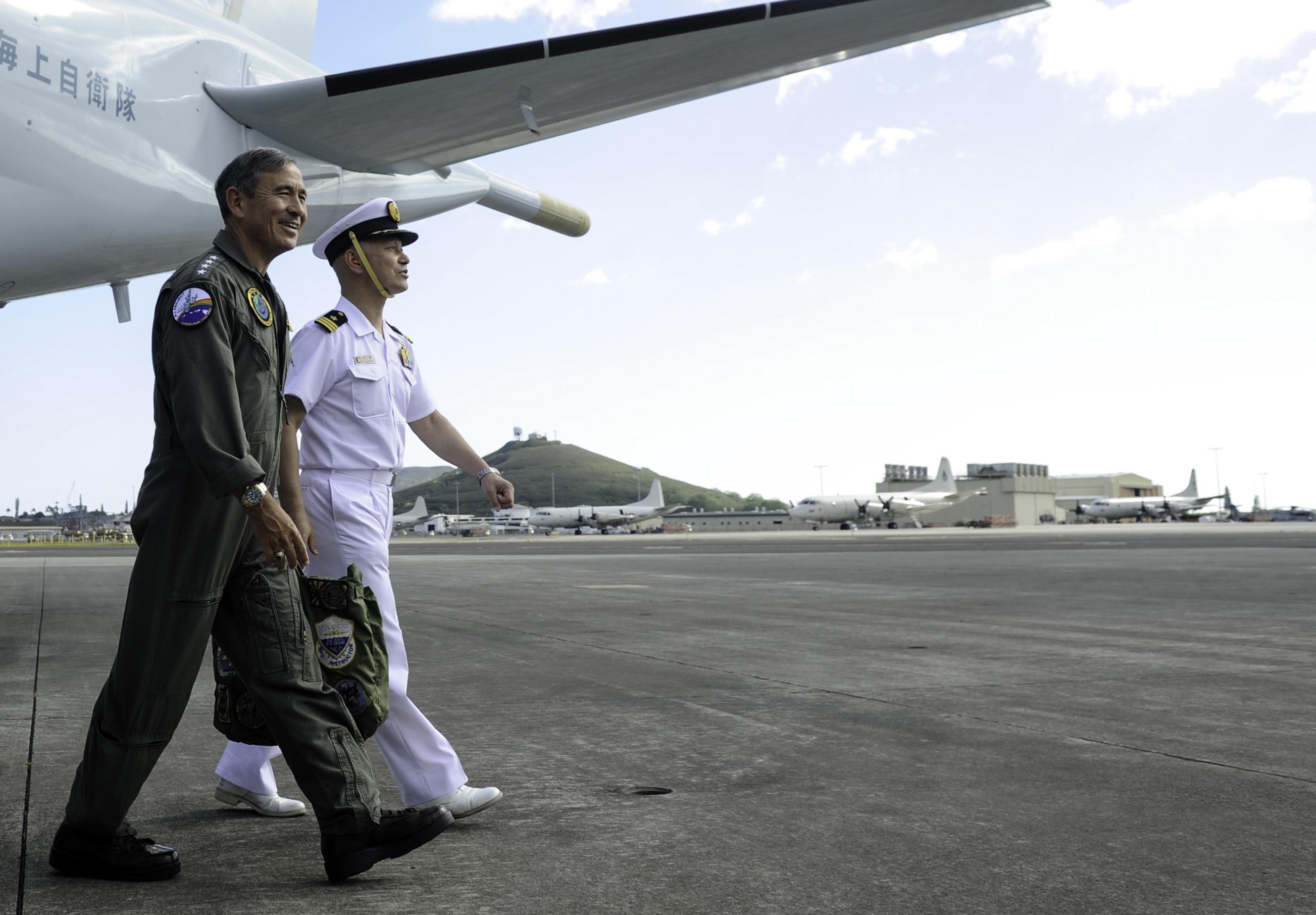 Adm. Harry B. Harris Jr., commander of U.S. Pacific Fleet, walks with Japan Maritime Self-Defense Force Cmdr. Kazutaka Sugimoto on Feb. 6, 2015. US Navy Photo