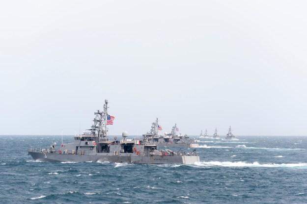 Cyclone-class coastal patrol ship USS Hurricane (PC 3) and other coastal patrol ships assigned to Patrol Coastal Squadron 1 (PCRON 1) transit in formation during a divisional tactics exercise.PCRON 1 is deployed.