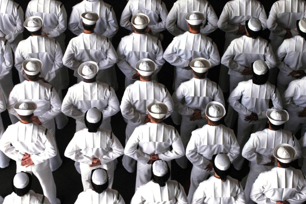 Sailors stand in formation during a change of command ceremony held aboard the Nimitz-class aircraft carrier USS John C. Stennis (CVN-74) in 2006. US Navy Photo