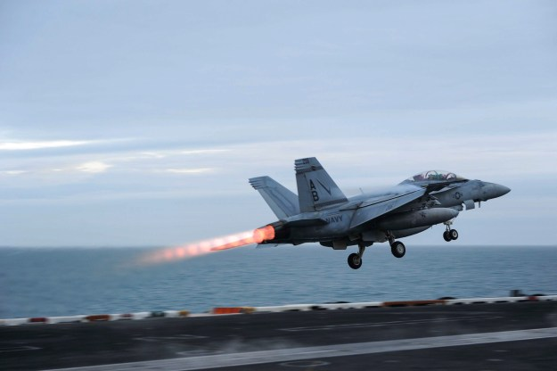 An F/A-18F Super Hornet assigned to the Checkmates of Strike Fighter Attack Squadron (VFA) 211 launches from the aircraft carrier USS Theodore Roosevelt (CVN-71) in March. A Super Hornet from the squadron crashed in the Persian Gulf on Tuesday. US Navy Photo
