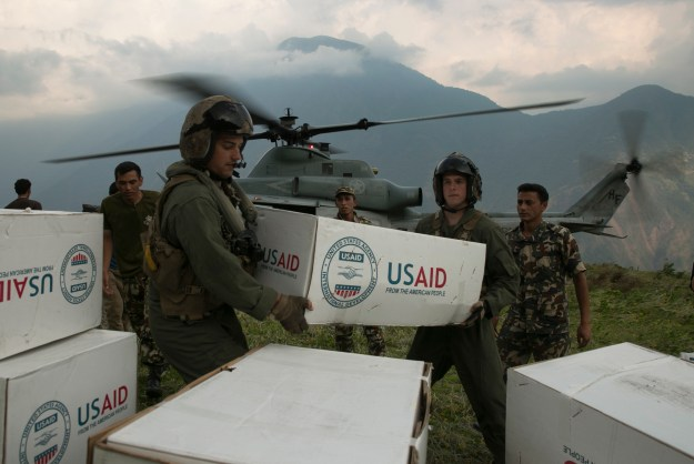 U.S. Marines and Nepalese soldiers unload tarps off of a UH-1Y Huey at Orang, Nepal, during Operation Sahayogi Haat, May 19. US Marine Corps photo.