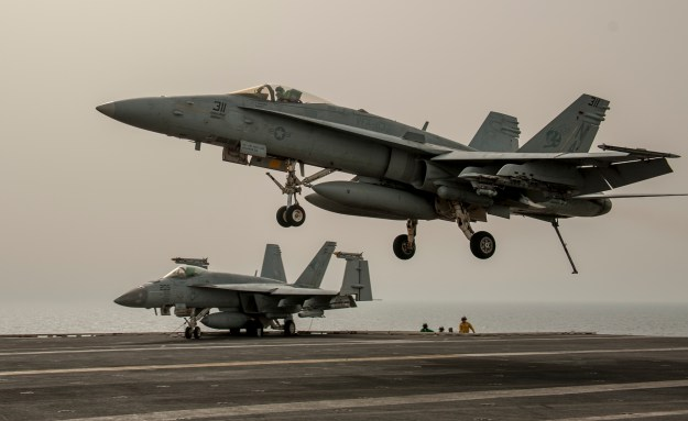 An F/A-18C Hornet attached to the Stingers of Strike Fighter Squadron (VFA) 113 makes an arrested recovery during the final flight operations in support of Operation Inherent Resolve aboard the aircraft carrier USS Carl Vinson (CVN 70) on April 11, 2015. US Navy photo.