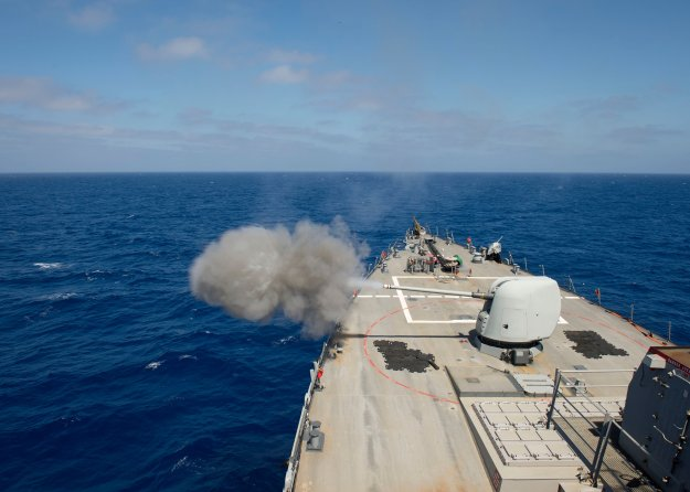 USS Ross (DDG-71) test fires the MK45 5-inch lightweight gun on April 30, 2015. US Navy Photo