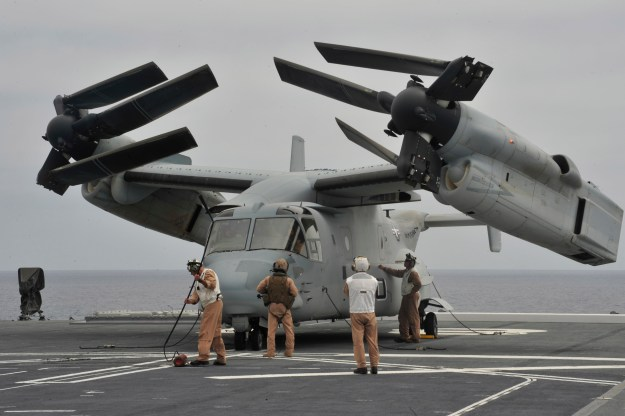 U.S. Marines inspect an MV-22 Osprey tilt-rotor aircraft after landing on the Japan Maritime Self-Defense Force helicopter destroyer JS Hyuga (DDH 181) during amphibious exercise Dawn Blitz 2014. US Navy photo.