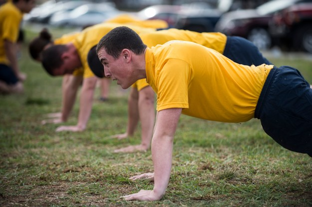 Sailors assigned to the amphibious dock landing ship USS Comstock (LSD-45) perform pushups as part of the Navy's physical readiness test (PRT) in 2013. US Navy Photo