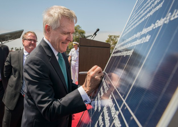 Secretary of the Navy (SECNAV) Ray Mabus signs a solar panel during a ceremony commemorating an agreement with Western Area Power Administration and Sempra U.S. Gas & Power to construct a 210 megawatt direct current solar facility. US Navy Photo