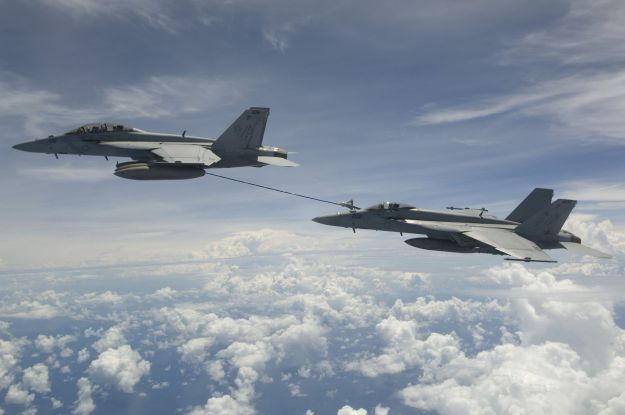 An F/A-18F refueling an F/A-18E over the Bay of Bengal, 2007. US Navy photo courtesy Wikipedia.