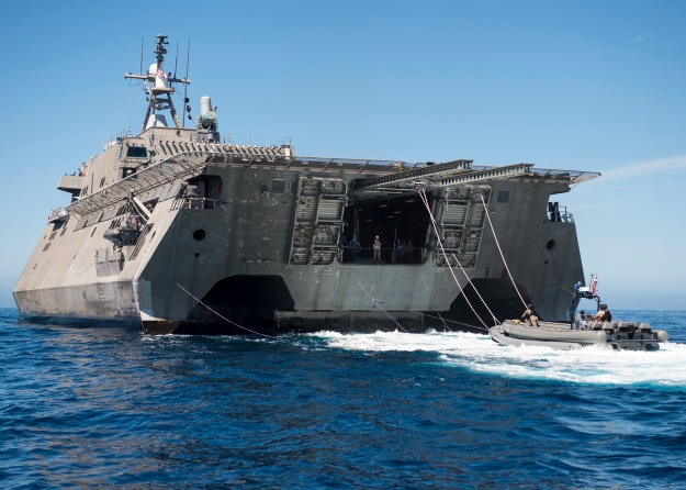 150815-N-KR961-068 PACIFIC OCEAN (Aug. 15, 2015) Sailors assigned to Surface Warfare Mission Package Detachment 2 prepare to be hoisted out of the water by the littoral combat ship USS Coronado's (LCS 4) twin-boom-extensible crane following a visit, board, search and seizure training exercise. Coronado conducted predeployment assessment and evaluation on the performance of shipboard equipment during a week-long underway off the coast of California. (U.S. Navy photo by Mass Communication Specialist 2nd Class Debra Daco/Released)