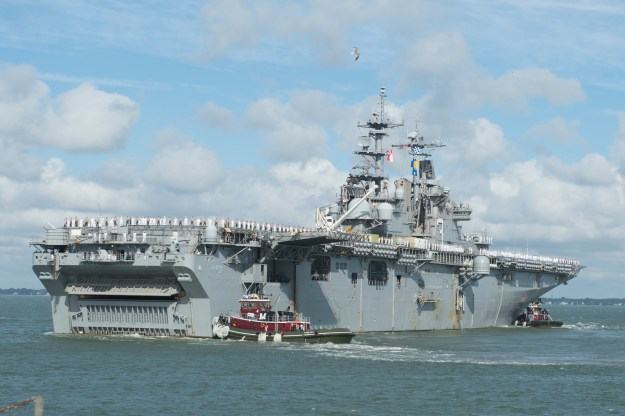 The amphibious assault ship USS Kearsarge (LHD-3) as the ship departs for deploymentOct. 6, 2015. US Navy Photo