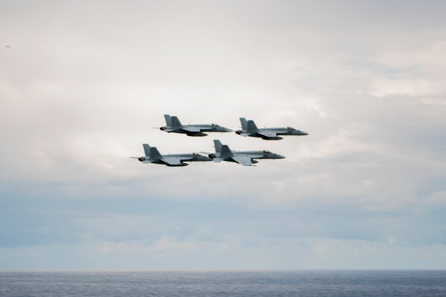 Aircraft assigned to Carrier Air Wing 7 perform a formation flyby off the port side of aircraft carrier USS Harry S. Truman (CVN 75) on Dec. 13, just prior to the ship transiting from U.S. 6th Fleet to U.S. 5th Fleet. US Navy photo.