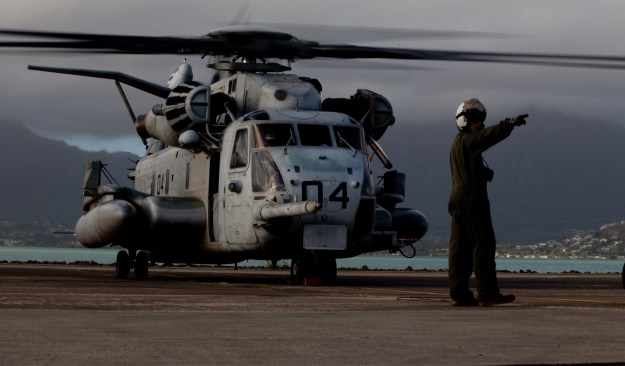 A Marine with Marine Heavy Helicopter Squadron 463 taxis a CH-53E Super Stallion onto the flight line at Marine Corps Air Station, Kaneohe Bay on Feb. 21, 2012. US Marine Corps photo.