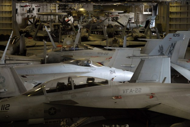 Aircraft assigned to Carrier Air Wing (CVW) 14 fill the hangar bay of the Nimitz-class aircraft carrier USS Ronald Reagan (CVN 76) to full capacity for the first time in more than three months, in March 2008. US Navy photo.