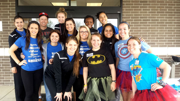 MEMBERS OF THE GRIZZLY Volleyball team at Missouri State University-West Plains served as volunteers during the April 26 Ozarks Medical Center (OMC) Fun Run in West Plains.  The student athletes helped with registration, handed out and gathered timing sensors, worked water stations, conducted manual timing of participants, and helped elsewhere when needed.  Above are, front row from left, Grizzly Adrijana Mazulovic, OMC Cancer Center Radiation Therapist Christy Chambers and OMC Media Relations Specialist Shandi Brinkman.  Second row: Grizzlies Brianna Zebert, Paris Witte, Kaili Simmons, Alyssa Aldag and Laiz Novaes, and OMC Wellness Coordinator Stephanie James.  Back row: Grizzly Helena Peric, OMC Foundation Executive Director Ward Franz, and Grizzlies Ashley Bishton, Lee Lee Barrett and Nella Ioramo.  (Photo provided)