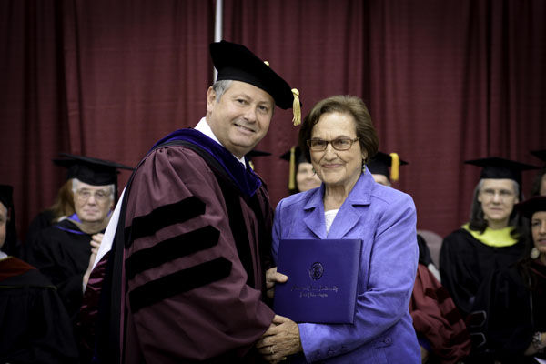 WEST PLAINS RESIDENT PEGGY KISSINGER received an honorary Associate of Arts degree Saturday, May 17, during Missouri State University-West Plains' commencement ceremony at the West Plains Civic Center arena.  She received her degree from Missouri State-West Plains Chancellor Drew Bennett.  (Missouri State-West Plains)
