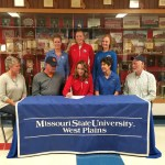 "FIRST SIGNING FOR 2017 SEASON – Paula Wiedemann, head coach of the Missouri State University-West Plains Grizzly Volleyball team, picked up her first recruit for the 2017 season this week when Missouri Class 3A All-State honorable mention honoree Koty Cooper of East Newton High School in Granby inked her letter of intent. Cooper racked up numerous honors her senior season, including Big 8 Conference Player of the Year, while helping her Lady Patriots to a 17-15 season record. ""We are excited to have Koty as a part of our incoming freshman class. She is athletic and continues to improve in her ability to play the game. Her size and strength make her a presence on the floor, and we look forward to watching her grow with our freshmen. She is a great start to our 2017 recruiting class,"" Wiedemann said. On hand for the signing were, seated from left above, stepmother Vonda Cooper, father Steve Cooper, Koty Cooper, mother Sara Camerer and stepfather Pat Camerer; standing: Wiedemann, East Newton High School Volleyball Coach Erin Rice, and Grizzly Volleyball Assistant Coach Briana Walsh. (Photo provided)"