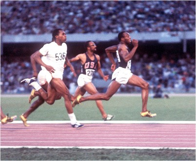 Jim Hines (front) became the first person to go under 10 seconds in the 100 meters.