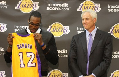 Dwight Howard and Los Angeles Lakers general Manager Mitch Kupchak at a press conference formally announcing the acquisition of the NBA All-Star. Photo Credit: Burt Harris/Courtesy of HGSTAR1News