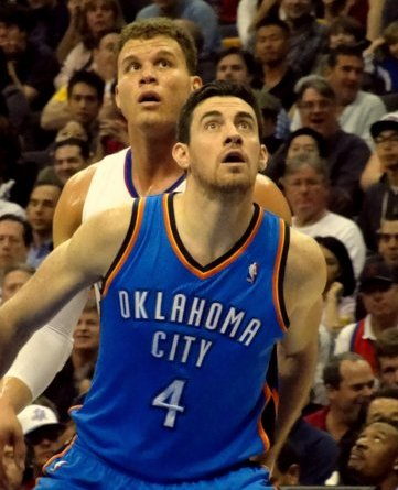 Blake Griffin of the Los Angeles Clippers, tries to outduel Oklahoma City's Nick Collison for a rebound at Staples Center.