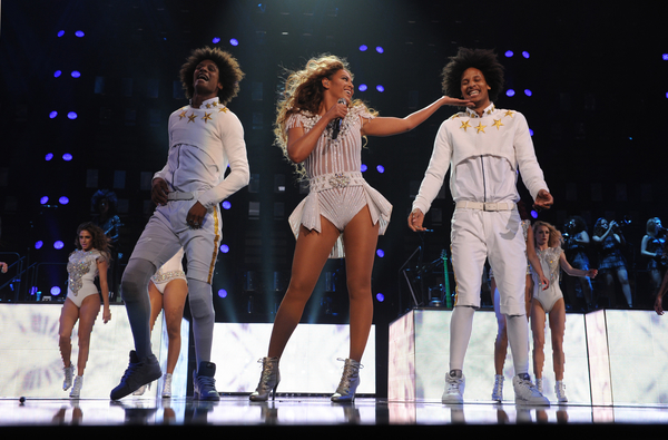 """Singer Beyonce performs on her """"Mrs. Carter Show World Tour 2013"""", during the BET Experience music festival on Friday June 28, 2013, in Los Angeles. Beyonce is wearing a custom hand beaded peplum one-piece by Ralph & Russo with shoes by Stuart Wieztman. (Photo by Frank Micelotta/Invision for Parkwood Entertainment/AP Images)"""