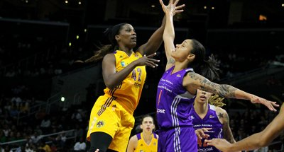 Los Angeles Sparks center Jantel Lavender goes up to score two of her 10 points against the Phoenix Mercury in a WNBA contest played at Staples Center Sunday, July 5, 2015. Photo Credit: Dennis J. Freeman