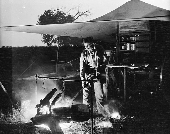 cowboy cooking on a fire