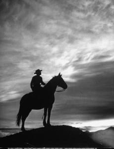 Cowboy silhouette against sky