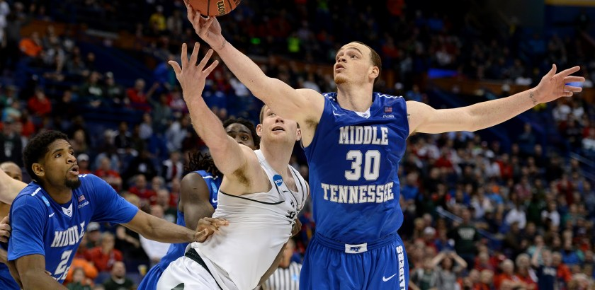 Matt Freed/Post-Gazette Middle Tennessee's Reggie Upshaw pulls down a rebound against Michigan State's Matt Costello Friday in the second round of the NCAA tournament in St. Louis.