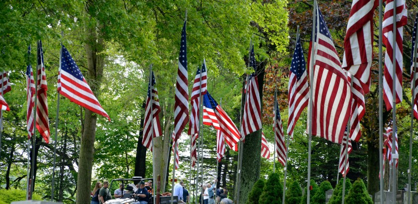 Darrell Sapp/Post-Gazette / West Newton, Pa. — 05/13/2016— for Local— STAND ALONE — 22nd Annual West Newton Avenue of Flags— Full size U.S. Flags line part of the West Newton Cementery. The West Newton VFW Post 7812, West Newton Moose Lodge 31, about 40 students from Yough High School student council and 10 members of West Newton Volunteer Fire Department  raised the 353 full-sized American flags at the West Newton Cementery , for the Memorial Day holiday.    digital image #dsc8121         slug — 20160513dsWNewtonFlagsLocal03.jpg