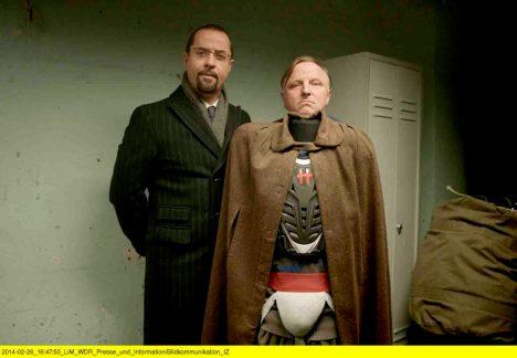 """Einem als Superheld verkleideten Mörder müssen Thiel und Boerne im neuesten Münster-Tatort """"Der Hammer"""" auf die Spur kommen. Am 27. März um 19 Uhr ist die WDR-Produktion im Cineplex als Kinopremiere zu sehen. Foto: WDR"""