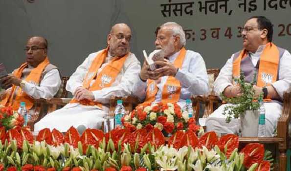 NEW DELHI, AUG 3 (UNI):- Prime Minister Narendra Modi in conversation with Union Home Minister Amit Shah at a Workshop Avhyas Varga for BJP parliamentarians at GMC Balayogi Auditorium at Parliament House, in New Delhi on Saturday.UNI PHOTO-AK8U