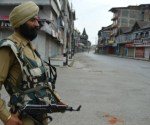 504866-indian-paramilitary-officer-in-kashmir-after-wani-death-afp