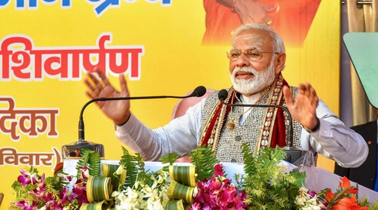 Varanasi: Prime Minister Narendra Modi addresses the closing ceremony of the Centenary Celebrations of Shri Jagadguru Vishwaradhya Gurukul at Jangamwadi Math in Varanasi, Sunday, Feb. 16, 2020. PM Modi also released the translated version of the Shri Siddhant Shikhamani Granth in 19 languages and a mobile app of the Granth. (PTI Photo)  (PTI2_16_2020_000058B)