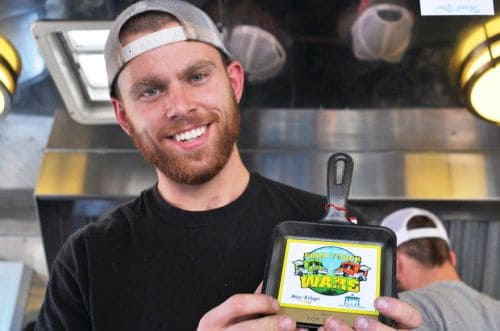 Ben Latham, general manager of Morris Grilled Cheese, holds up his Top Truck award. (Peter Genovese/The Star-Ledger)