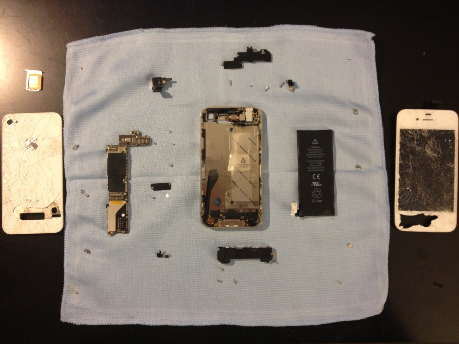 The entire phone completely disassembled looking at it from the back.