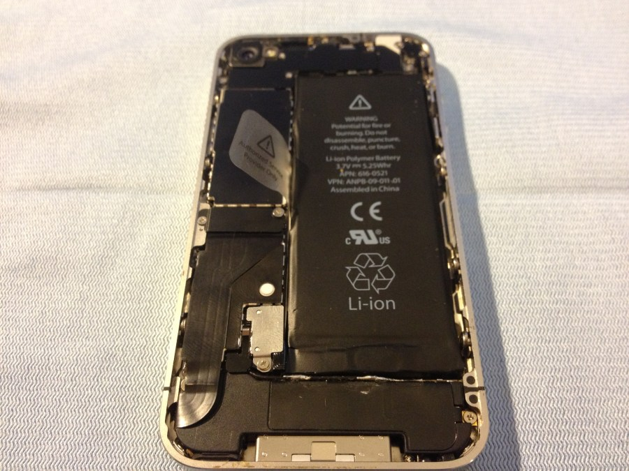 The iPhone completely reassembled, except for the back cover plate.