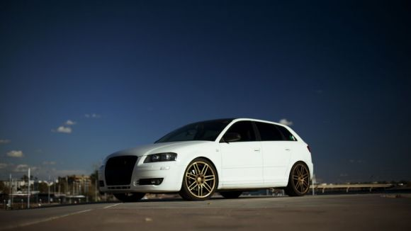 White A3 on Gold Wheels