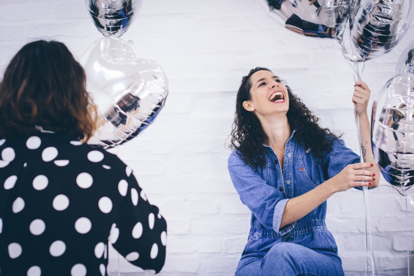 Selina laughing with balloons behind scenes