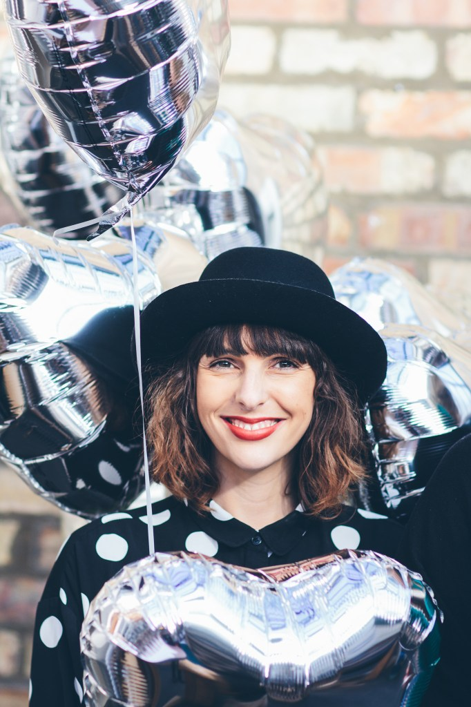 Vicki with balloons and hat
